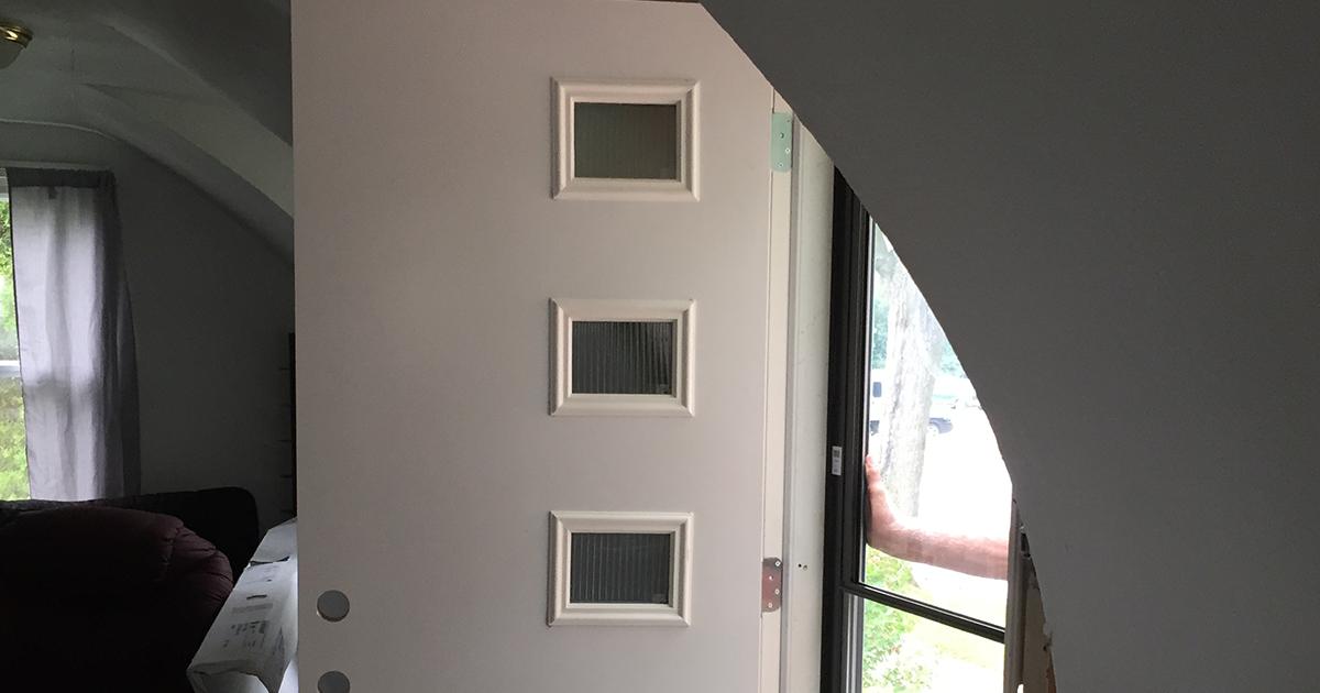 The new door on hinges.